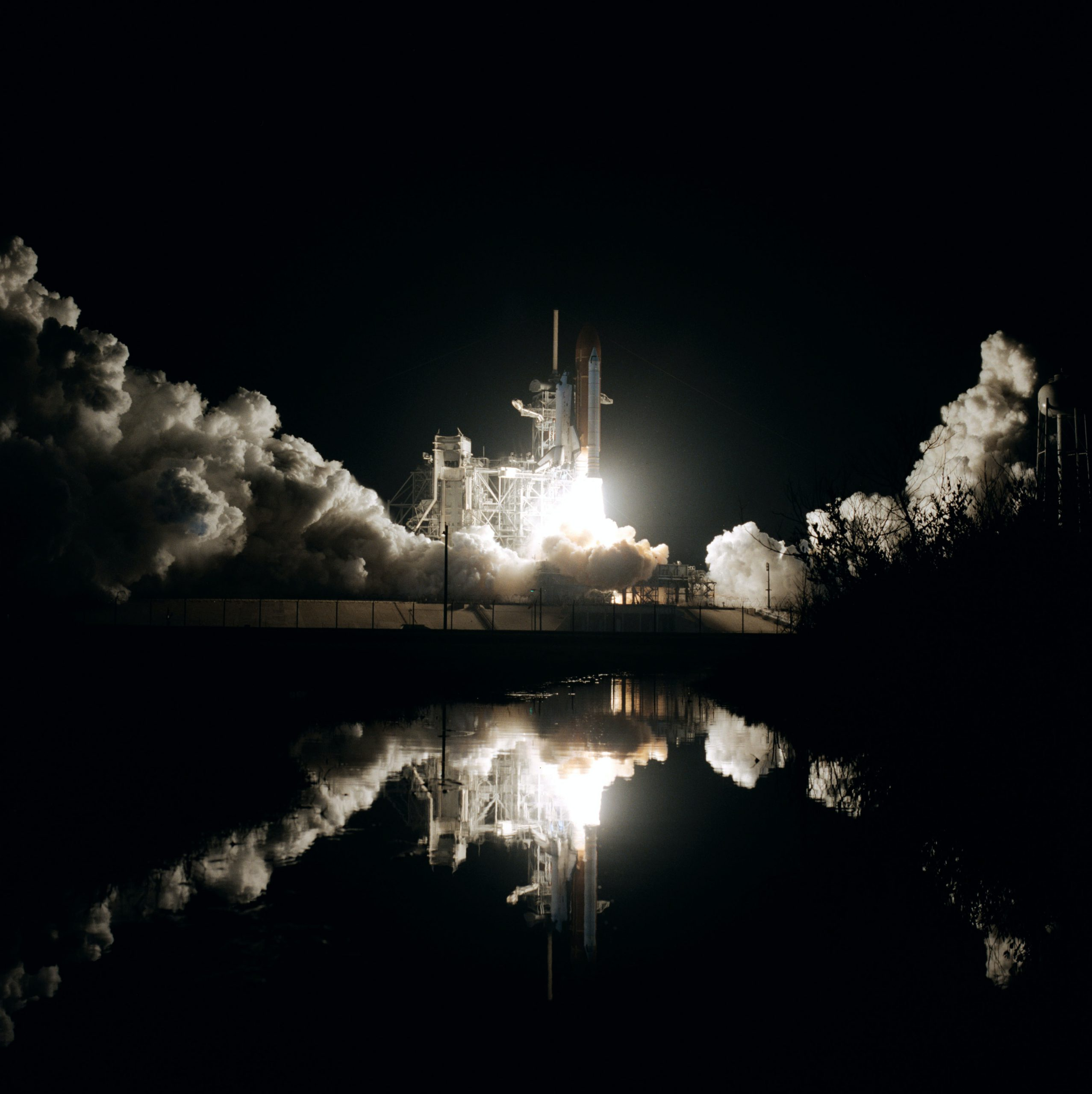 space shuttle launch and rocket explosion at night