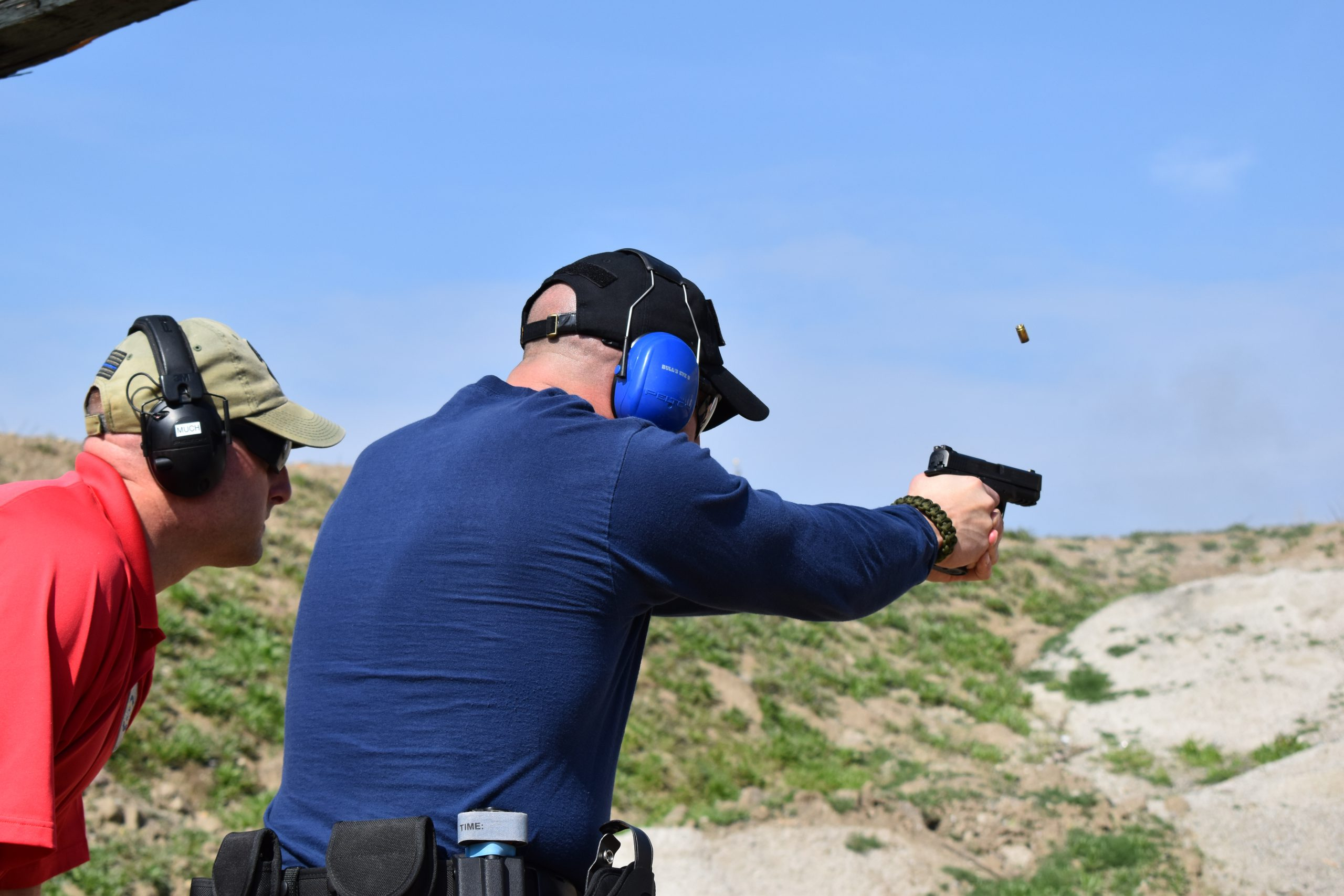 Security officers training at outside gun range