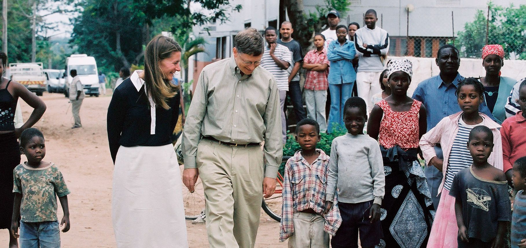 bill and melinda gates walk with children in third world country